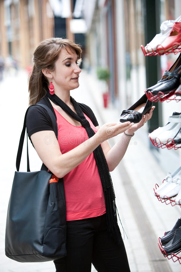 Download Checking For New Shoes Royalty Free Stock Photos - Image: 9745408