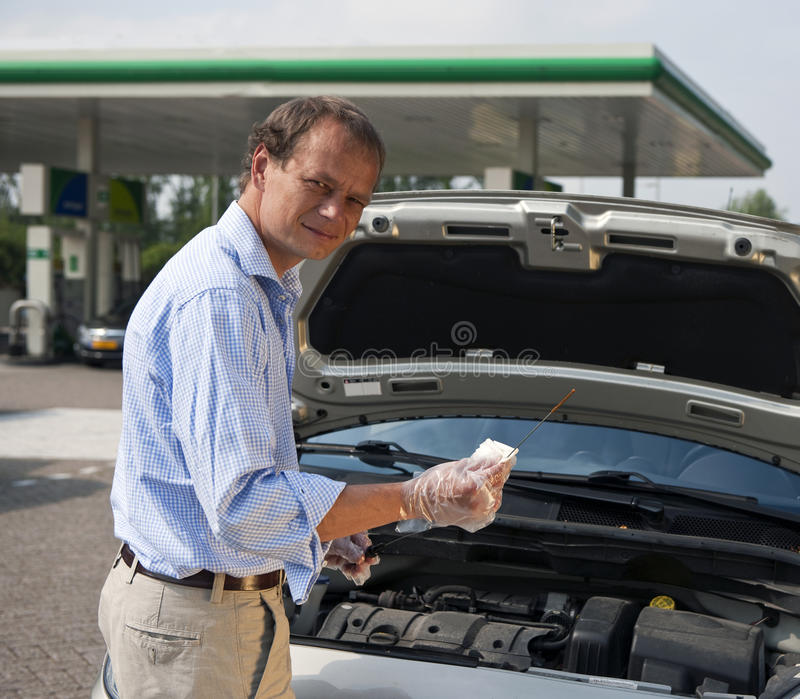 Download Checking oil levels stock photo. Image of clean, gauging - 20508346