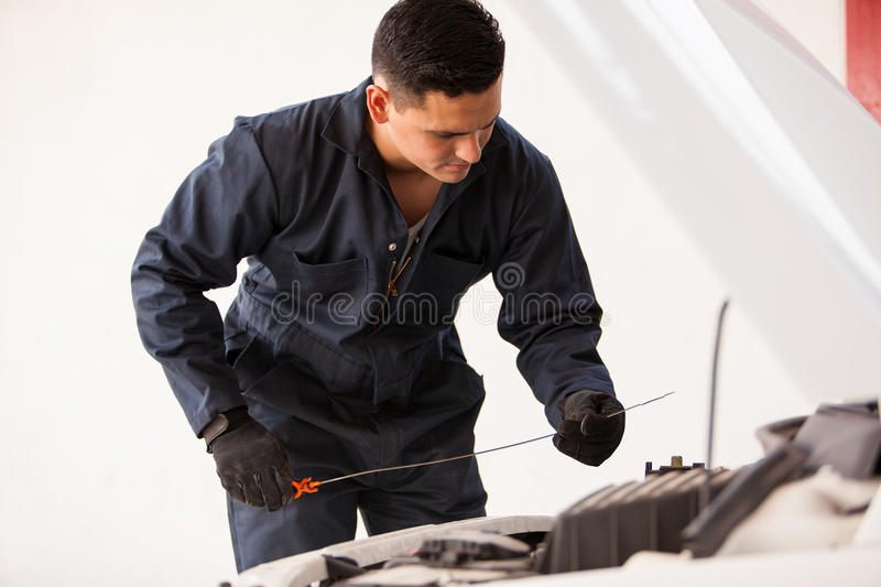 Download Checking Oil Levels Of A Car Stock Image - Image: 33750459
