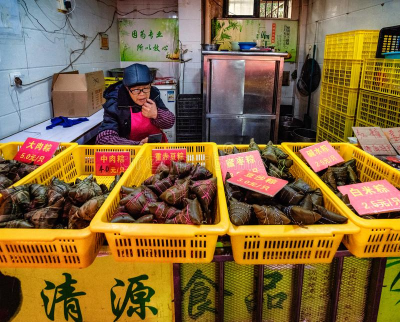 Checking online orders for freshly made Zongzi. royalty free stock photography