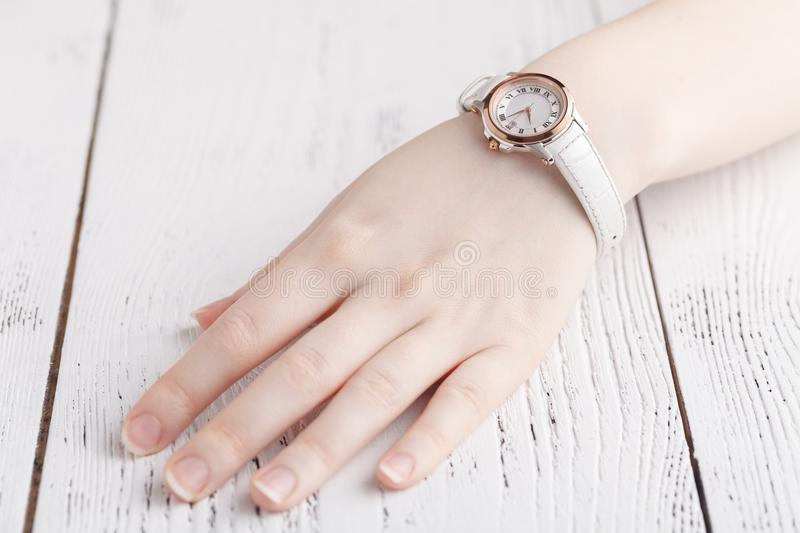 Checking time, female wrist watch on hand stock photos