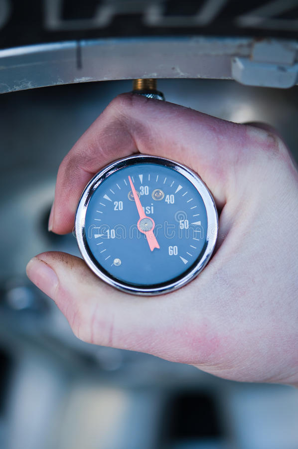 Download Checking Tire Pressure stock image. Image of hand, detail - 18879599