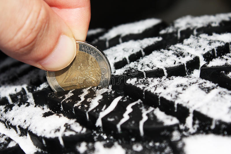 Download Checking Tire Tread Depth With A Two Euro Coin Stock Photo - Image: 17405348