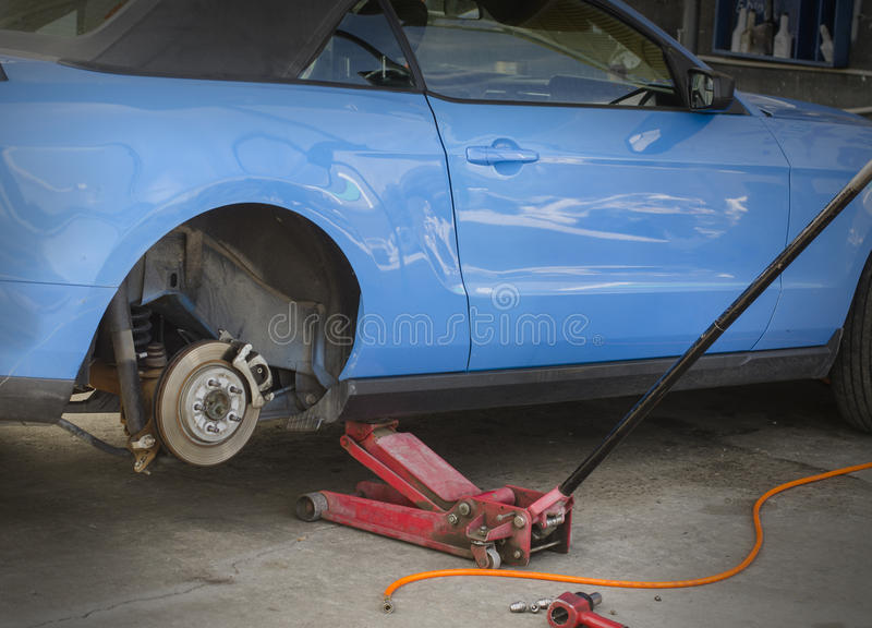 Checking wheels brakes on car. Checking service wheels brakes on car stock image