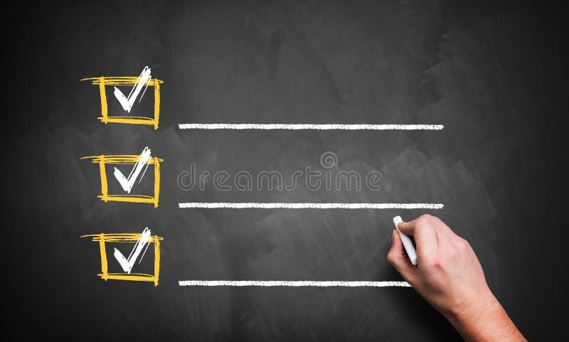 Checklist on a chalkboard stock photos