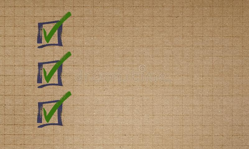 Checklist on checkered recycled paper writing pad concept royalty free stock image