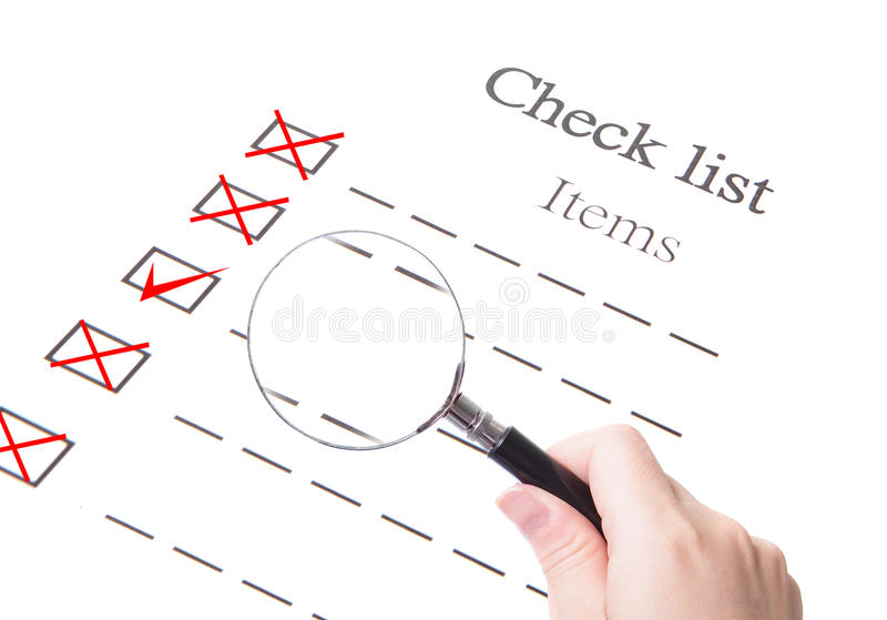 Checklist paper and magnifier glass close up