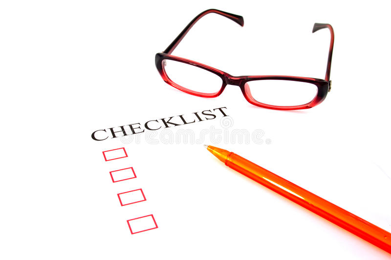 Checklist with pen, glasses and checked. Boxes stock photos