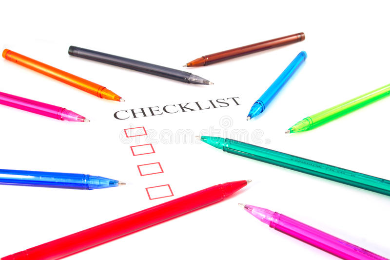Checklist with pens and checked. Boxes royalty free stock images