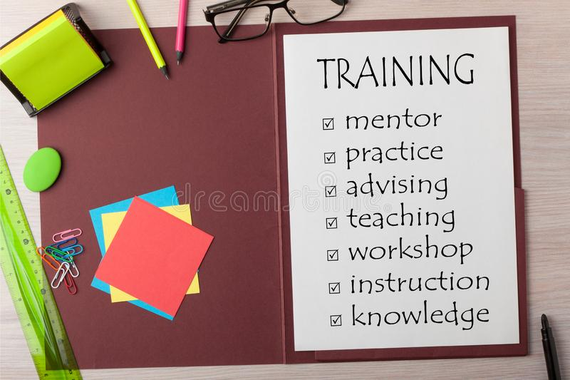 Checklist for Training Concept. Training checklist written on paper sheet on presentation folder and various stationery royalty free stock photography