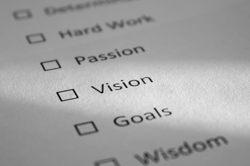 Checklist on a white sheet of paper with points Determination, Hard Work, Passion, Vision, Goals. The inscription Vision is stock image