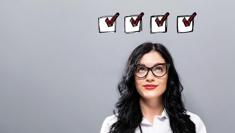 Checklist with young businesswoman royalty free stock image