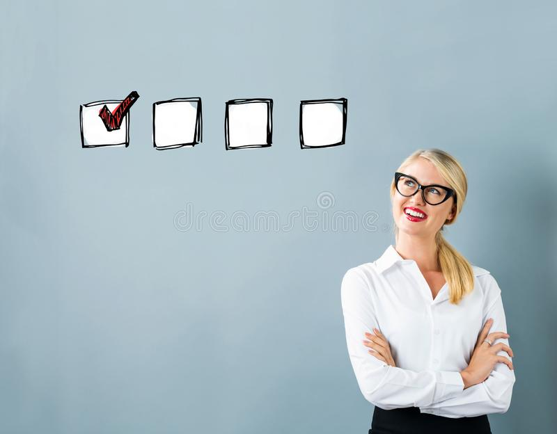 Checklist with young woman stock photography