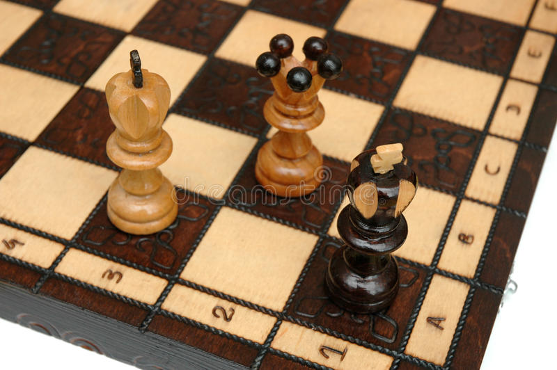 Checkmate. With qeens and king on chess board royalty free stock photos