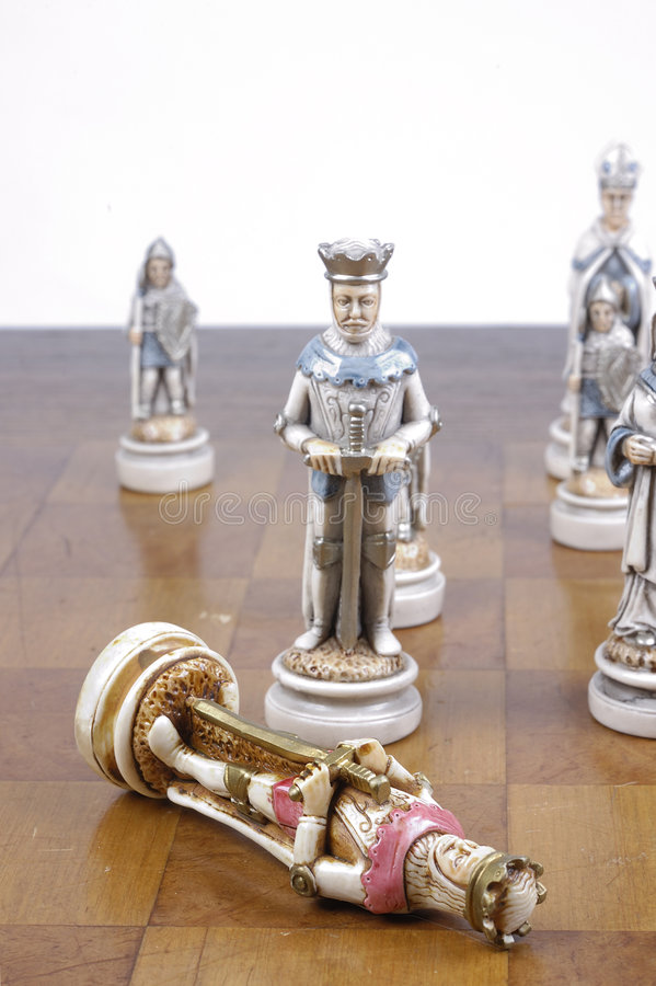 Checkmate. End of a game of chess with the red King checkmated stock photo