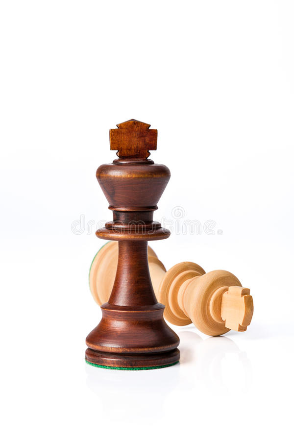 Checkmate black defeats white king. On white background royalty free stock photo