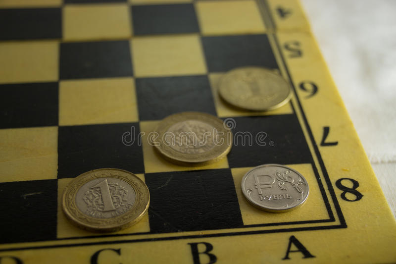 Checkmate for russian rouble. Russian economic crisis concept royalty free stock images