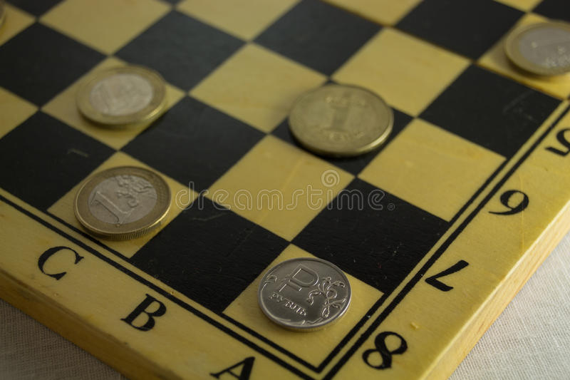 Checkmate for russian rouble. Russian economic crisis concept stock photos