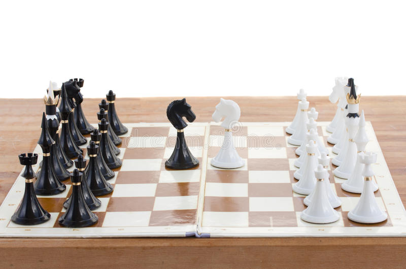 Checkmate white defeats black king. Checkmate white knight defeats black king close up stock photos