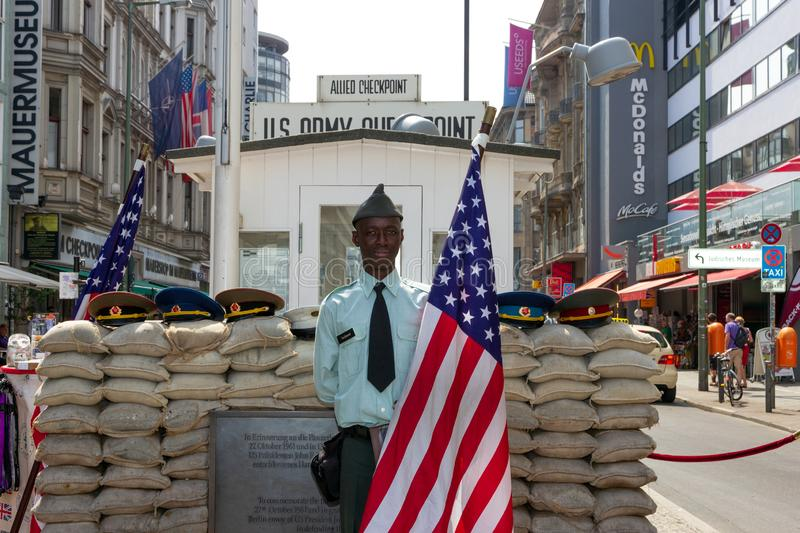 Checkpoint Charlie soldier Berlin stock photo