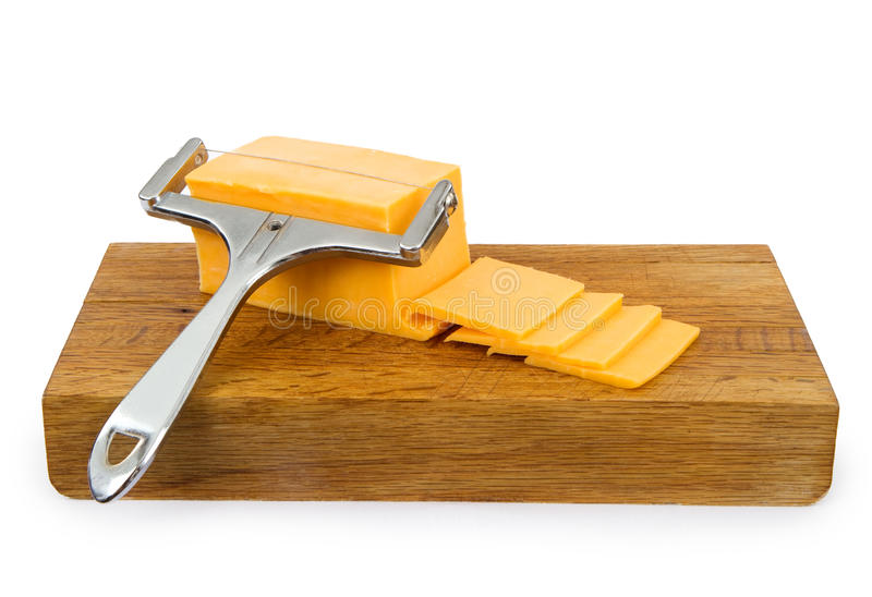Cheddar Cheese on a Cutting Board stock images