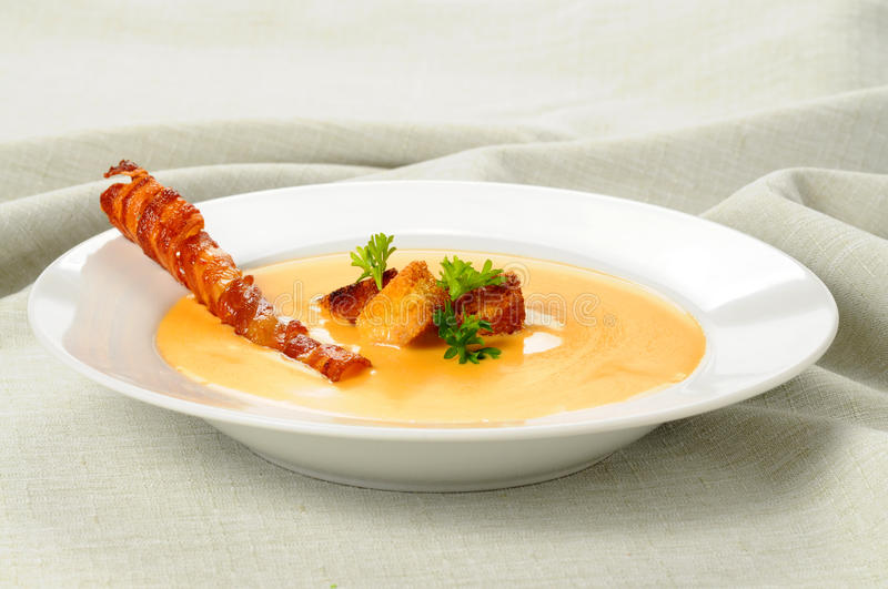 Cheddar Cheese Soup. Garnished with croutons and bacon royalty free stock photography