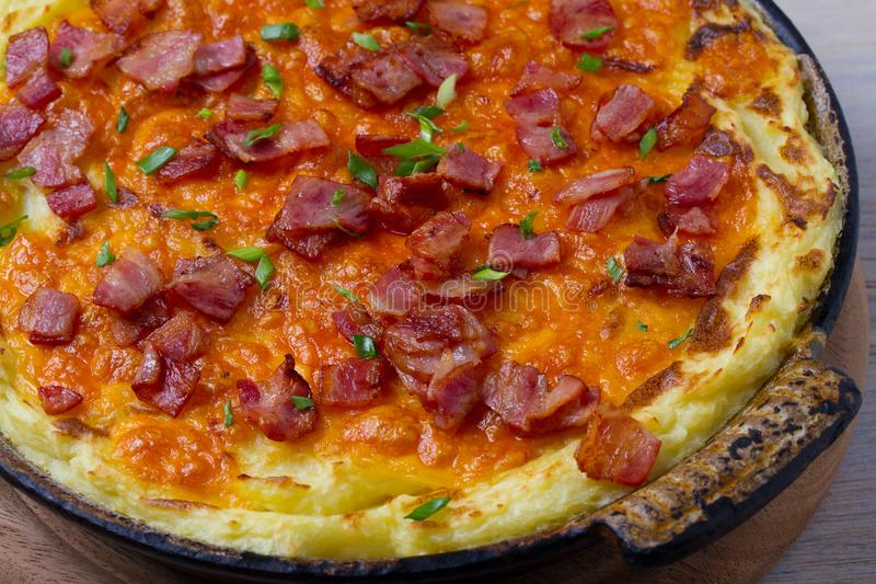 Cheddar Mashed Potato Casserole with Bacon. Baked Cheddar Potato Casserole. stock photos