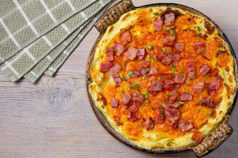 Cheddar Mashed Potato Casserole with Bacon. Baked Cheddar Potato Casserole. stock images