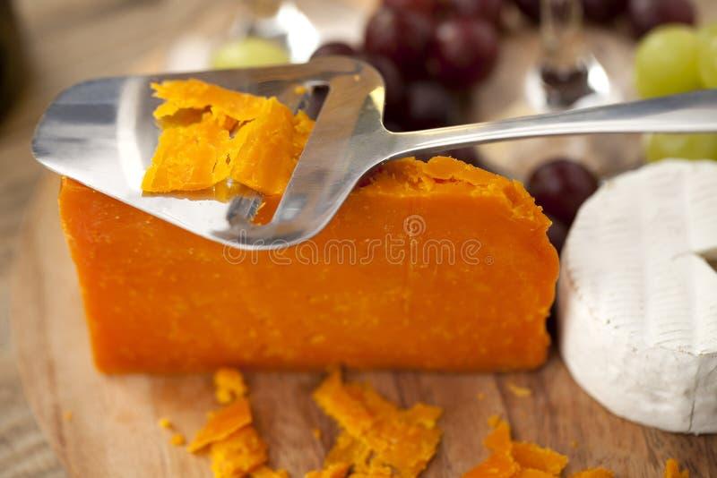 Cheddaru i feta pomarańczowy ser zdjęcia stock