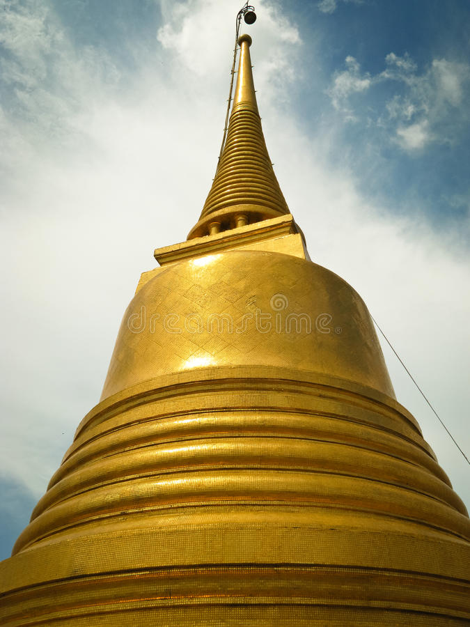 Chedi. A big golden chedi in Thailand royalty free stock photos
