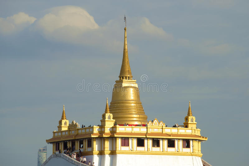 Chedi of the ancient Buddhist temple Wat Sacket Temple of the Golden Mount against the background of a cloudy sky. Bangkok, Thai stock image