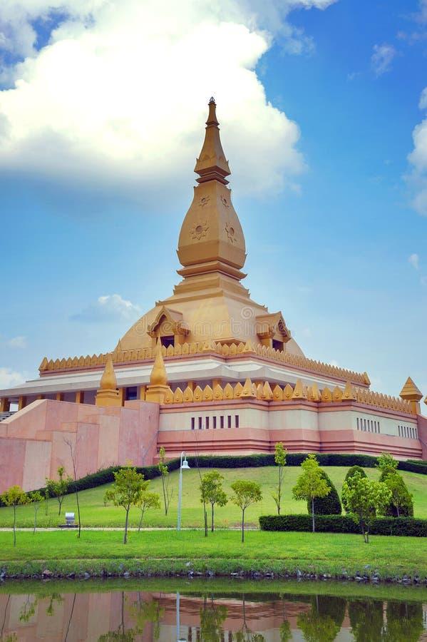 Chedi Maha Mongkol Bua, the golden pagoda landmark of Roi Et Province, northeastern Thailand.  stock photos