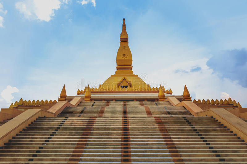 Chedi Maha Mongkol Bua, the golden pagoda landmark of Roi Et Province, northeastern Thailand.  royalty free stock photo