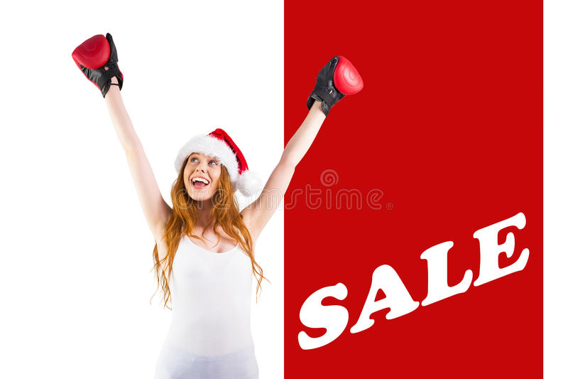 cheeering与拳击手套的欢乐红头发人的综合图象 免版税库存图片