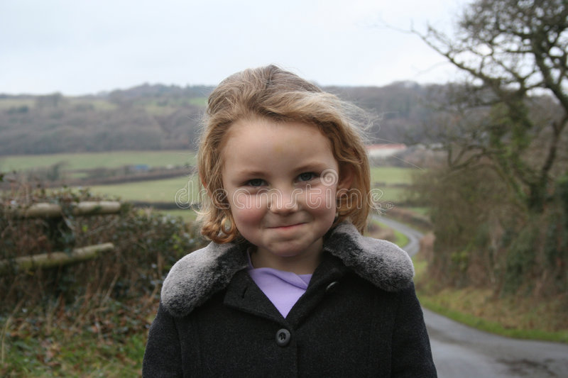 Cheeky looking girl on country walk stock photos