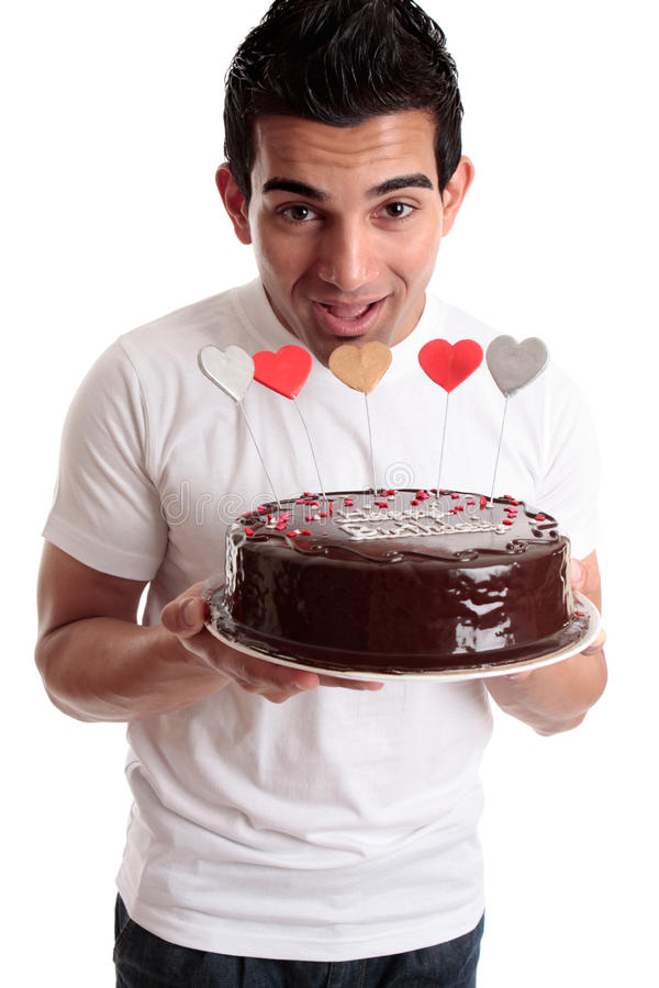 Cheeky Man With A Birthday Cake Royalty Free Stock Image