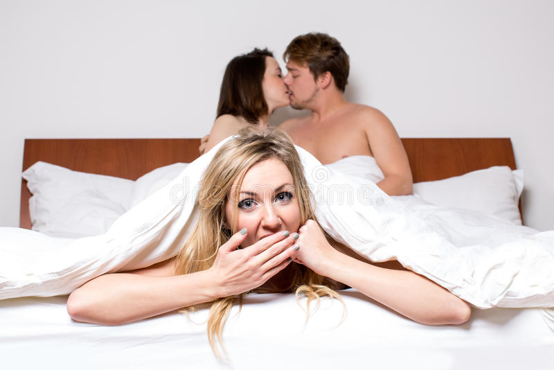 Download Cheeky Young Woman In A Threesome In Bed Stock Photo - Image of affair, three: 37781816