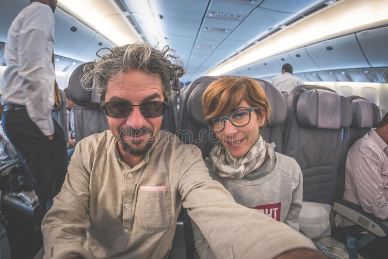 Cheerful adult caucasian couple taking selfie royalty free stock photos