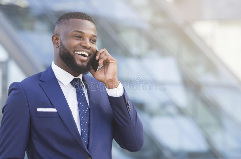 Cheerful African American Businessman Having Phone Conversation In City royalty free stock images