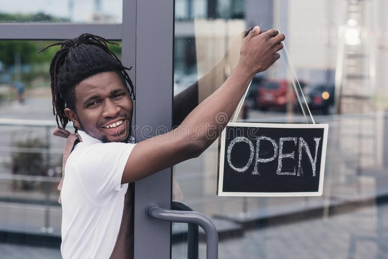 cheerful african american coffee shop owner stock photo