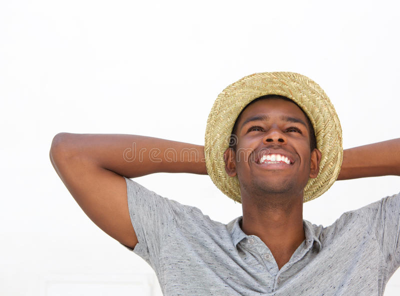 Cheerful african american man laughing with hat royalty free stock photo