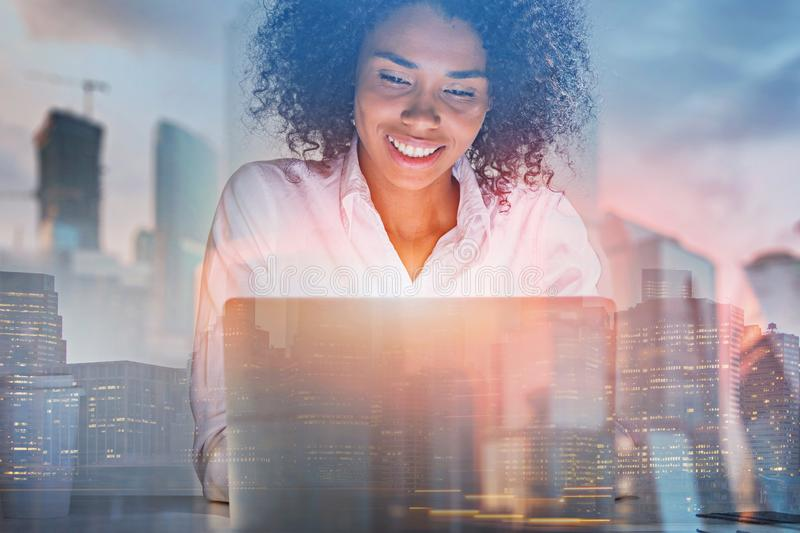 Cheerful African American woman with laptop royalty free stock images