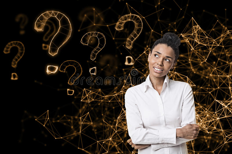 Cheerful African American woman virtual questions. Portrait of a smiling African American woman standing with crossed arms against an orange virtual reality royalty free stock photography