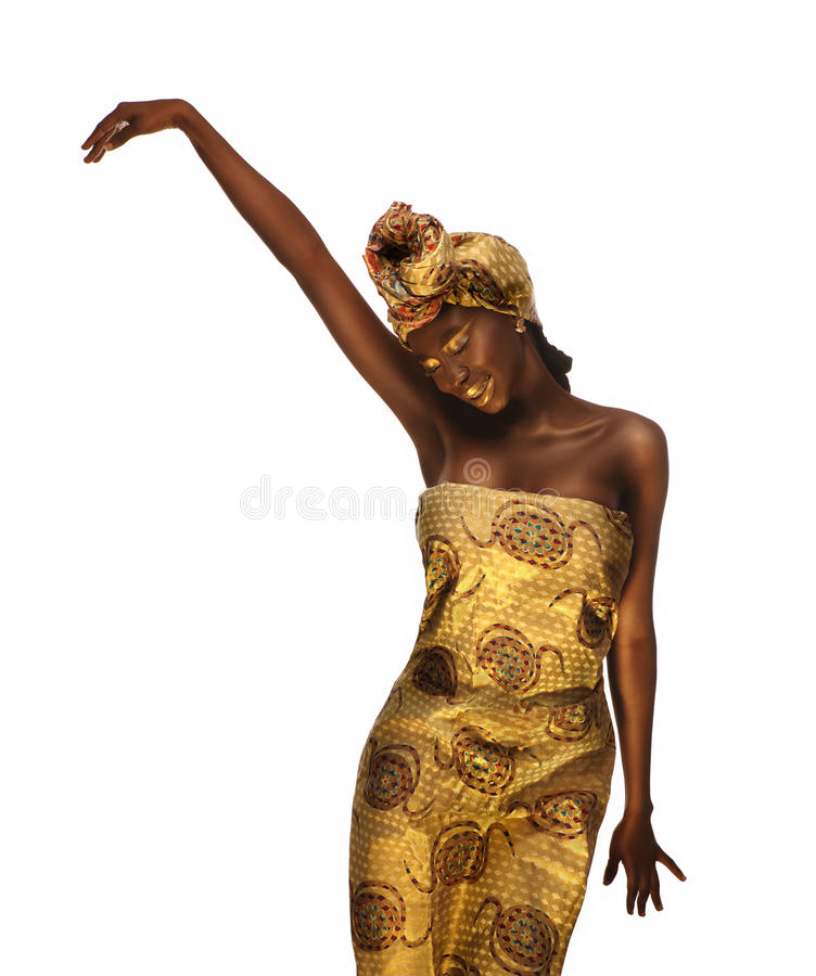 Cheerful african woman with creative gold make–up and turban royalty free stock photography