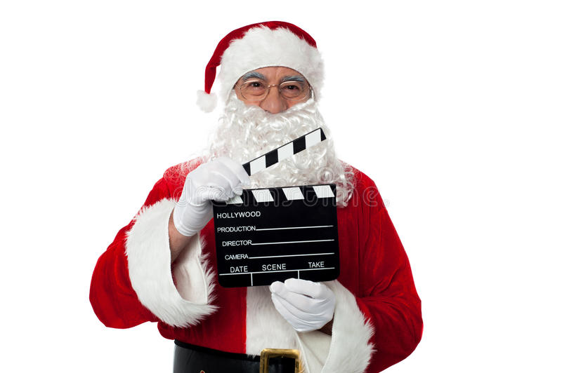 Download Cheerful Aged Santa Posing With A Clapperboard Stock Image - Image: 27837391