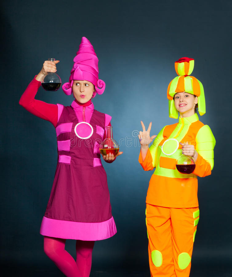 Cheerful animators with chemical flasks and test tubes royalty free stock photo
