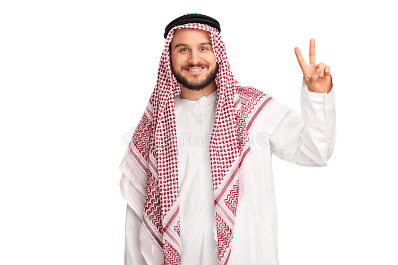 Cheerful Arab making a peace hand gesture stock images