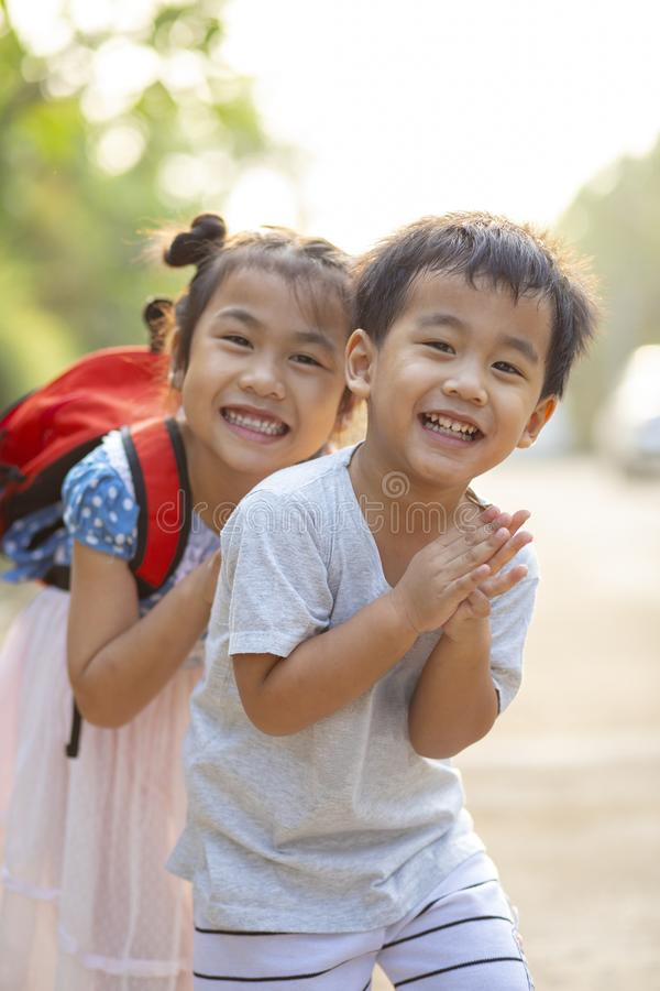 Cheerful asian brother and sister playing with happiness emotion royalty free stock image