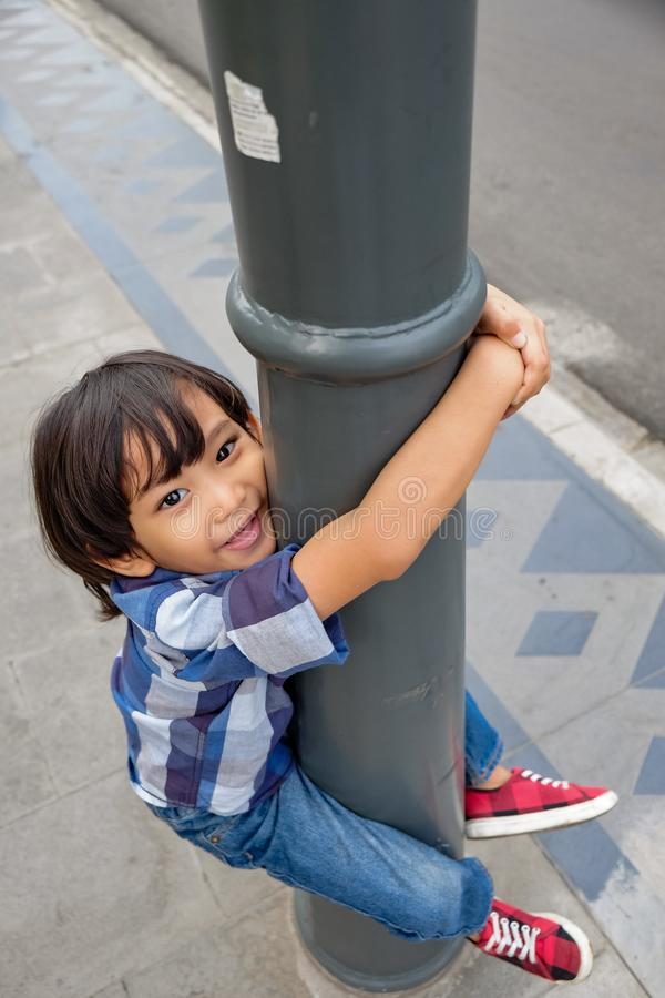 Cheerful Asian Child Having Fun on Sidewallk stock images