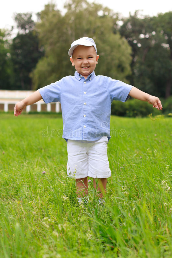 Cheerful asian child in the park stock photography
